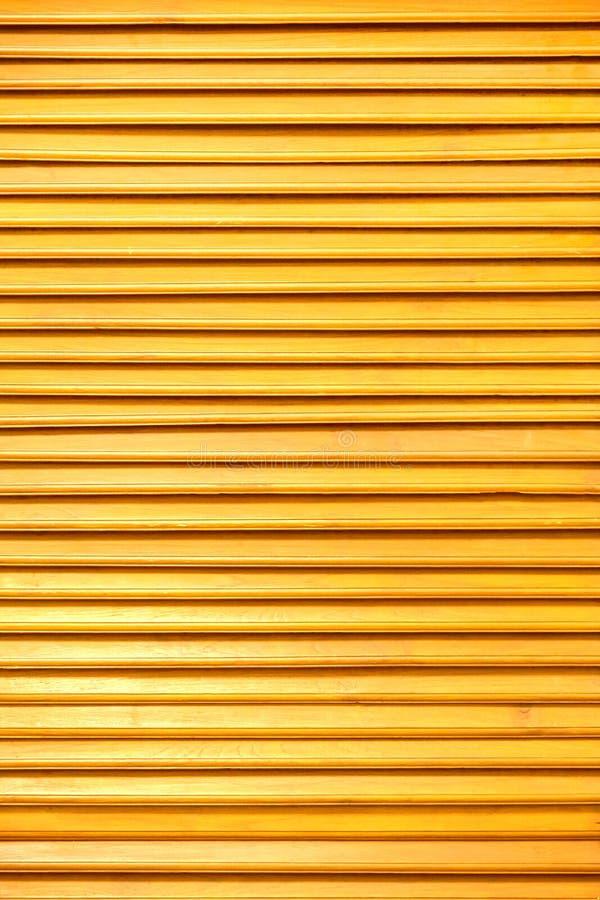 Slat. Orange brown wood texture royalty free stock image