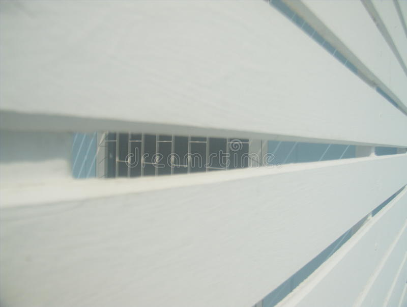 Slat wall. Slat wall openings for ventilation can see through royalty free stock images