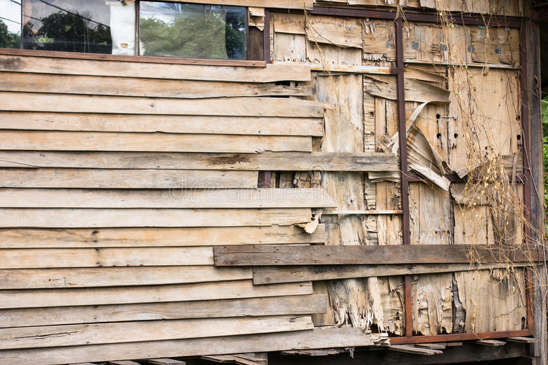 Slat Wall. Wooden slat wall of an abandoned house is peeling off due to none of attention royalty free stock photos