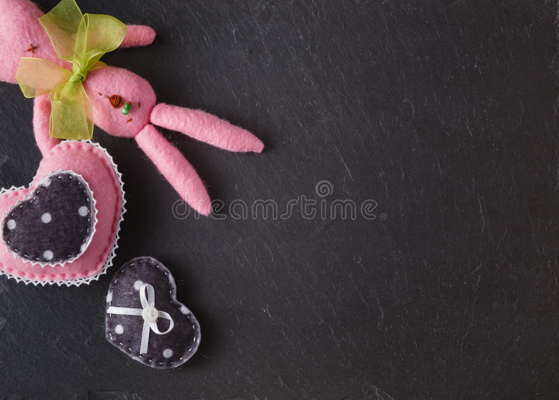 Slate board for message with soft felted toys stock image