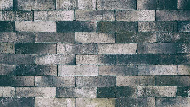 Slate brick stone wall background and texture royalty free stock photo