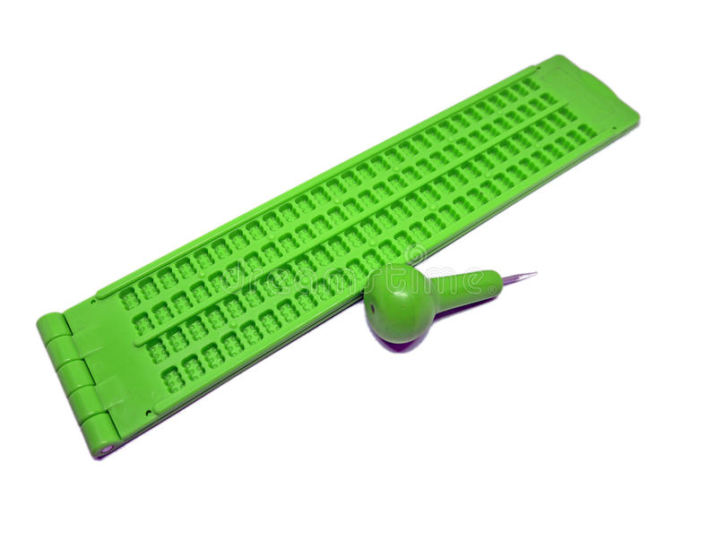 Slate pattern and stylus, braille writer tools. Green slate pattern and stylus, braille writer tools stock images