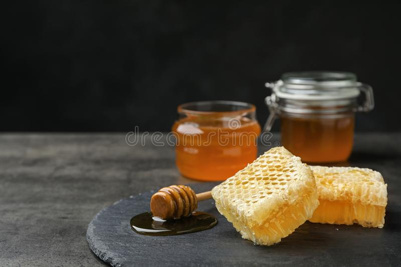 Slate plate with fresh honeycombs. On table stock photo