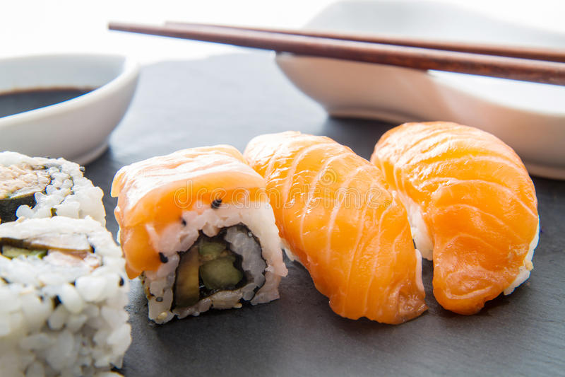 Slate plate with sushi food royalty free stock images