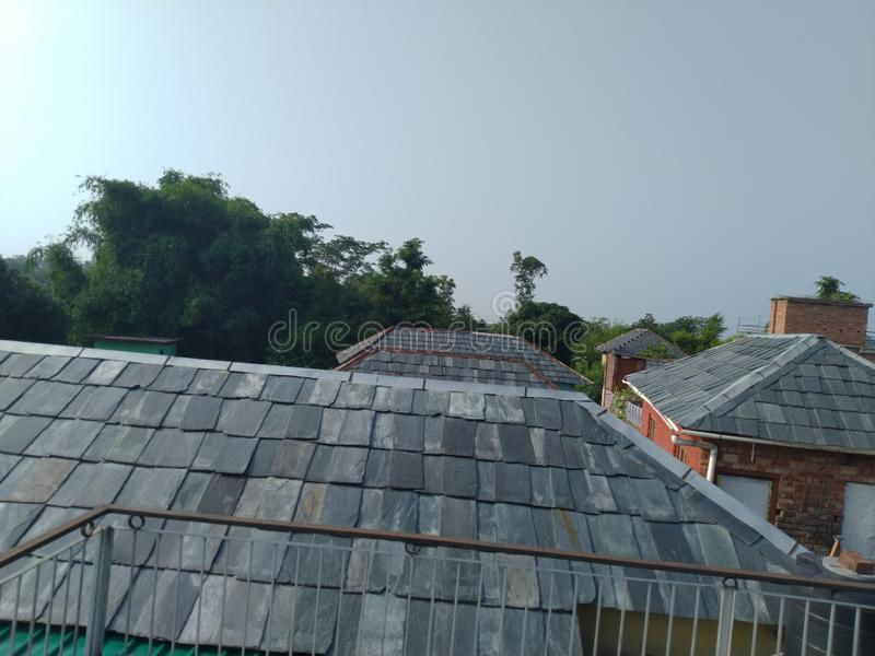 Slate roof in hp palampur. Beautiful slate roof of houses in  palampur hp india . People living in this way from centuries.climate controlled roof stock photo