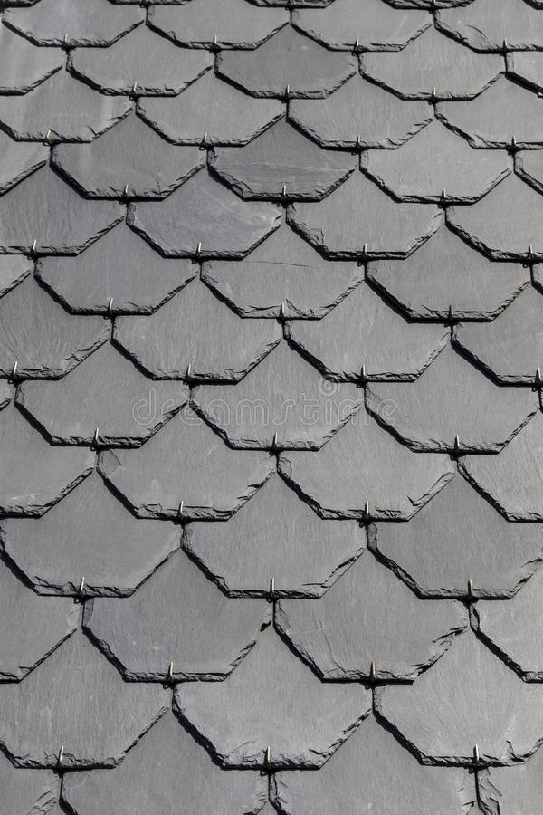 Slate shingles on a church roof, copy space, background. Close up of slate shingles of a vertical part of a church tower roof, copy space stock photos