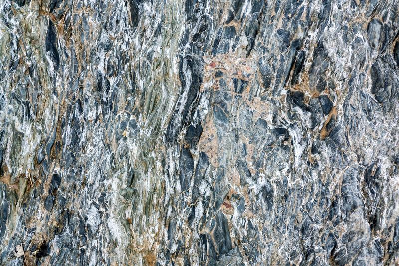 Slate stone surface in the mountains near Muscat, Oman.  stock image