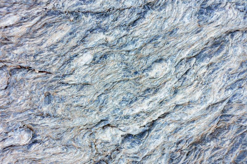 Slate stone surface in the mountains near Muscat, Oman.  royalty free stock photos