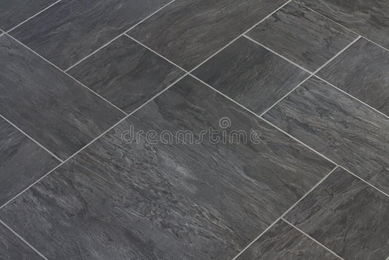 Slate stone texture vinyl floor tiles stock image