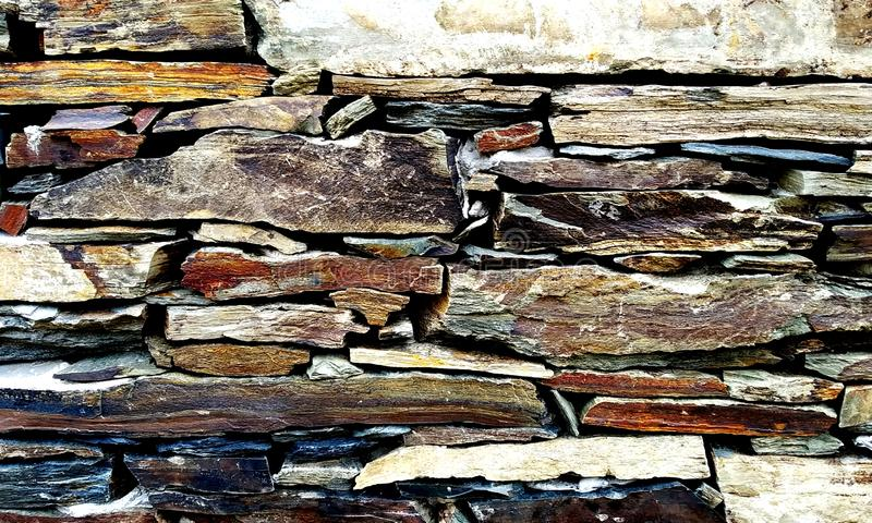 Slate Stone Wall.Closeup surface marble pattern at marble stone wall texture background royalty free stock photography