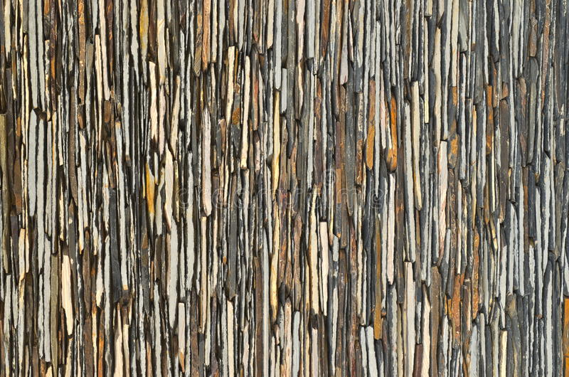 Slate stone wall surface. Pattern of decorative slate stone wall surface stock image