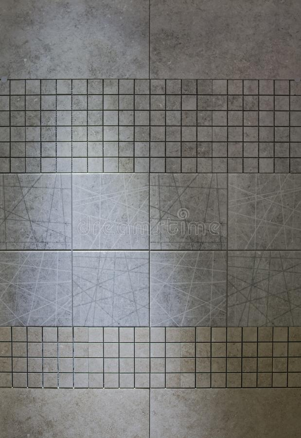 Slate tile ceramic, texture light gray.  Porcelain tile in the bathroom stock images