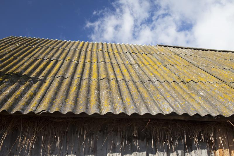 Slate tiled roof of old grunge wooden shed. Russia stock images