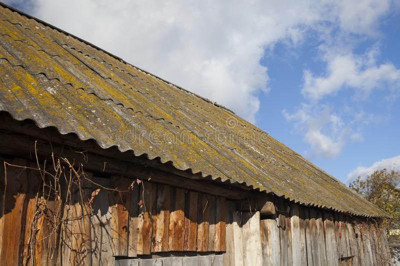 Slate tiled roof of old grunge wooden shed. Russia royalty free stock image