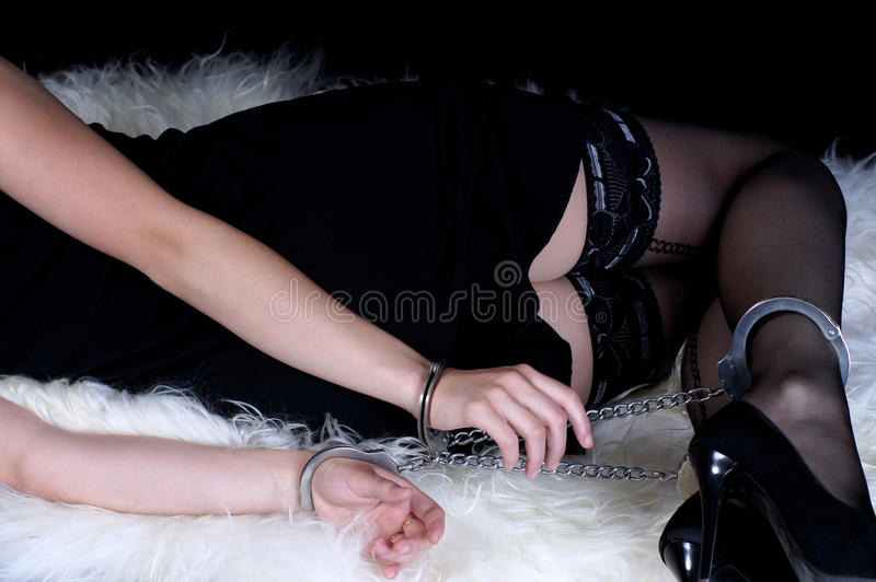 Slave girl in handcuffs stock photos