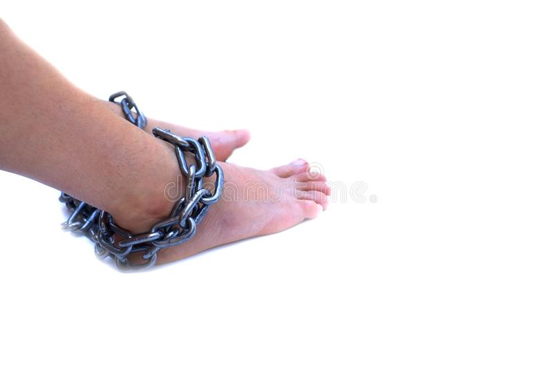 Slave woman leg tied up with steel chain on white background, Human rights violations, International Women`s Day royalty free stock photo