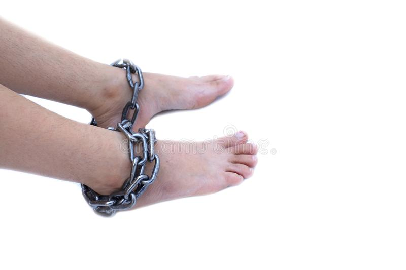 Slave woman leg tied up with steel chain on white background, Human rights violations, International Women`s Day royalty free stock images
