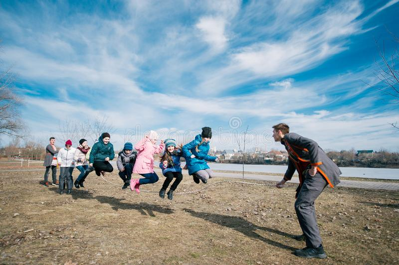 Slavic holiday of the end of winter. Happy children jumping on a jump rope royalty free stock photography