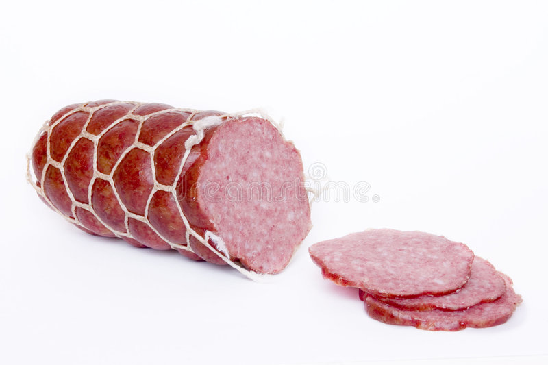 Slced sausage. On white background stock photo