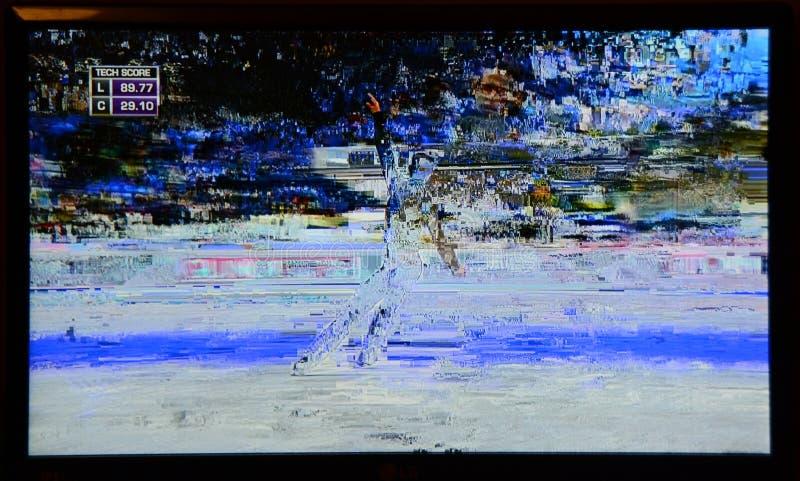 Slecht televisiesignaal tijdens de overdracht van kunstschaatsen royalty-vrije stock afbeelding