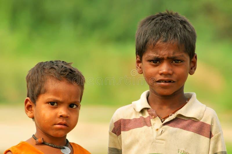 Slechte Indische jongens stock foto