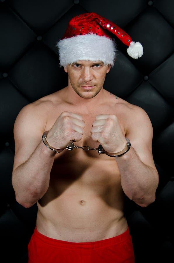 Slechte Kerstman in handcuffs stock foto