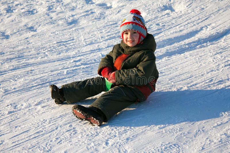 Sled. Little child fun winter outdoor snow sport sled stock images