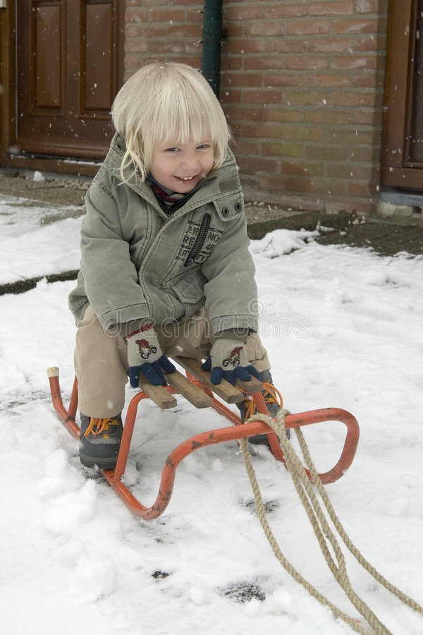 Sled. A boy on a sled royalty free stock photos