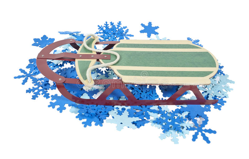 Download Sled On A Bed Of Colorful Snowflakes Stock Images - Image: 19969534