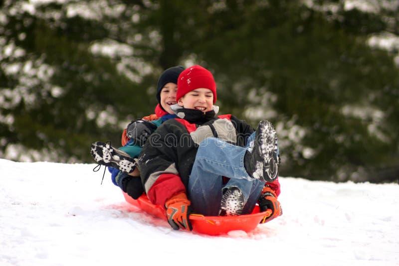 sledding的男孩 库存图片