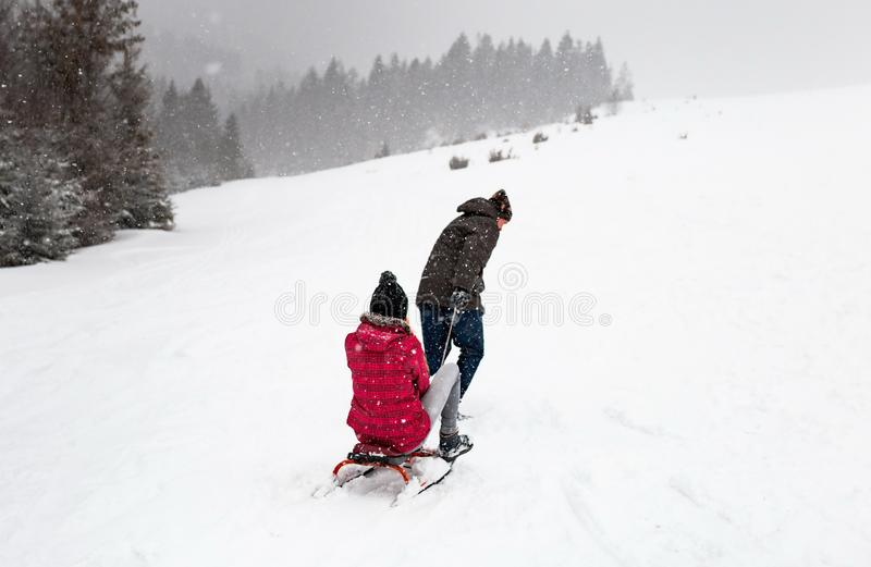 Sledding or ski mountain snow, winter sports activity, forest in snowfall cold, walk outdoor play fun. Sledding or ski mountain snow, winter sports activity stock images