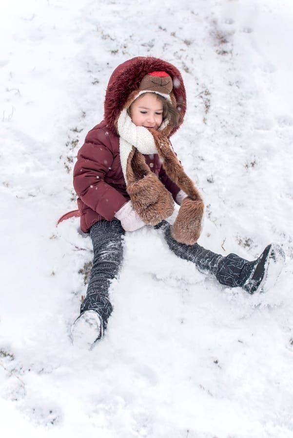 Sledding on snow. Little girl sledding on snow,selective focus and blurred motion stock photos
