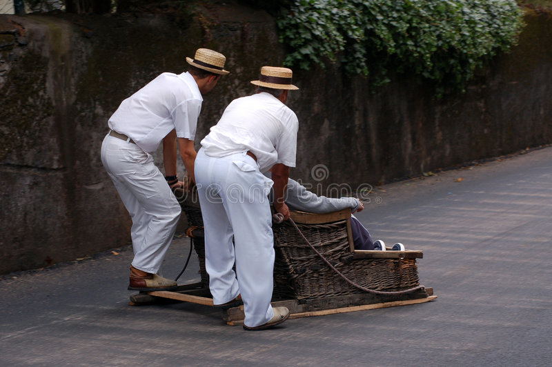 Sledge riding in funchal stock photos