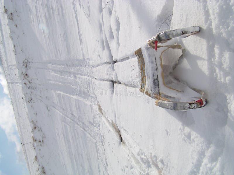 Sledge on the snow. Under the hill stock photos