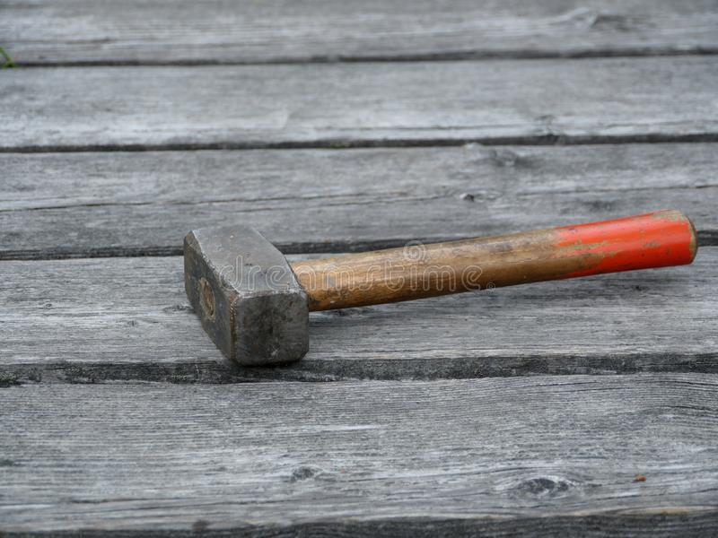 Sledgehammer on the old boards stock image