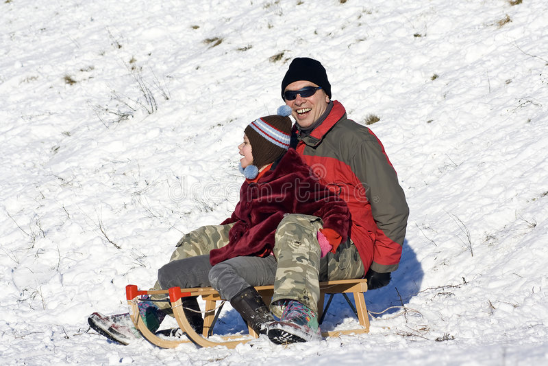 Sledging - divertimento do inverno imagem de stock