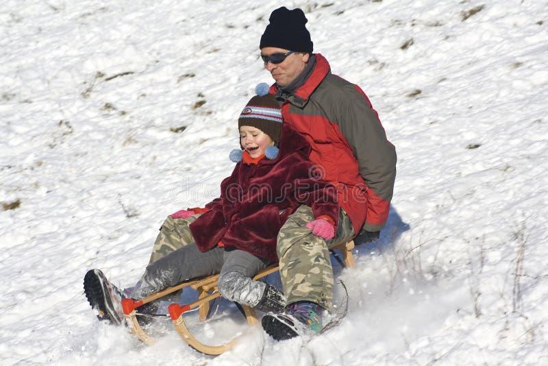 Sledging - divertimento do inverno imagem de stock royalty free