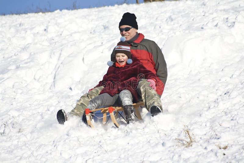 Sledging - divertimento do inverno foto de stock