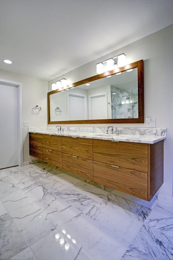 Sleek bathroom with double vanity cabinet royalty free stock image