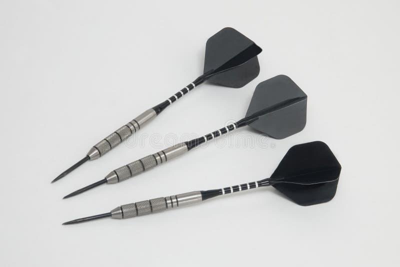 Sleek Black Titanium Throwing Darts royalty free stock photo