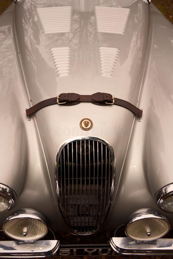 Sleek curves and lines of a vintage Jaguar XK120 roadster. Silver bonnet/hood of a Jaguar XK120 roadster, gleaming on display at Brooklands classic winter royalty free stock photo