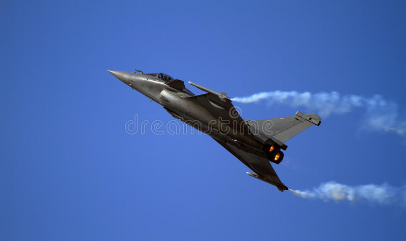 Sleek fighter zooming up into the sky