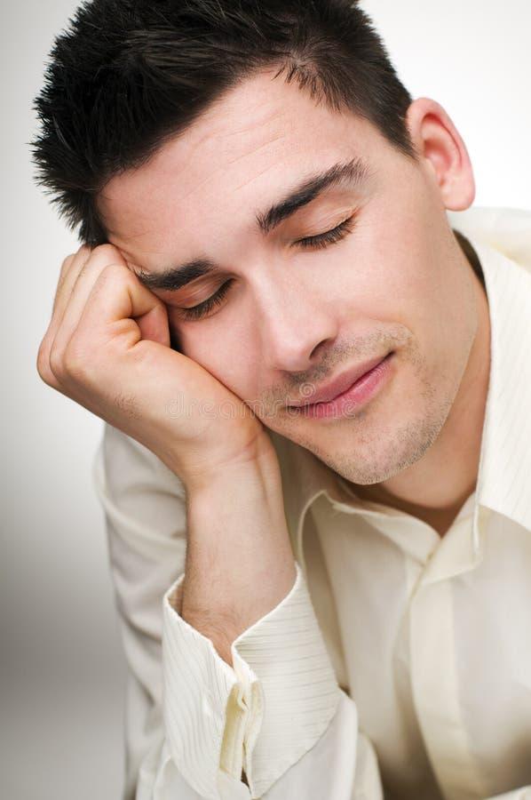 Sleep. Young hapy business man sleeping close up royalty free stock photos