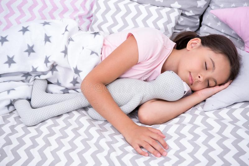 Sleep concept. Little girl sleep in bed. Cute child sleep with soft toy. Sleep well, stay healthy stock photography