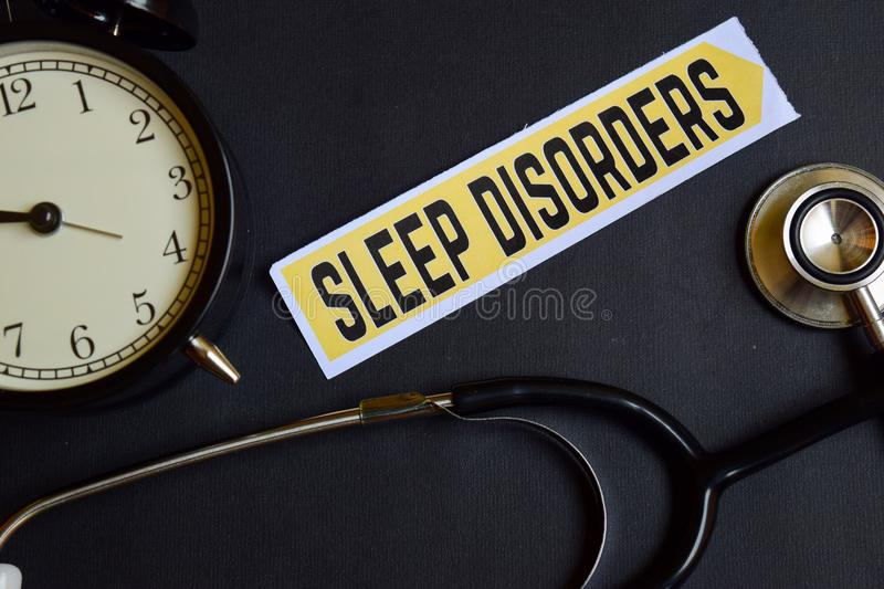 Sleep Disorders on the paper with Healthcare Concept Inspiration. alarm clock, Black stethoscope. royalty free stock images