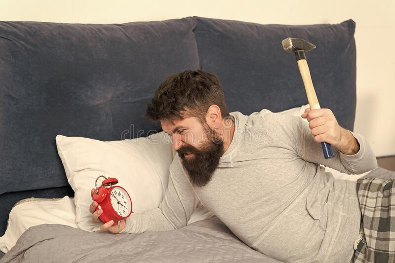 Sleep longer. Health care concept. Stages of sleep. Man awake unhappy with alarm ringing. Although you sleep you may stock photo