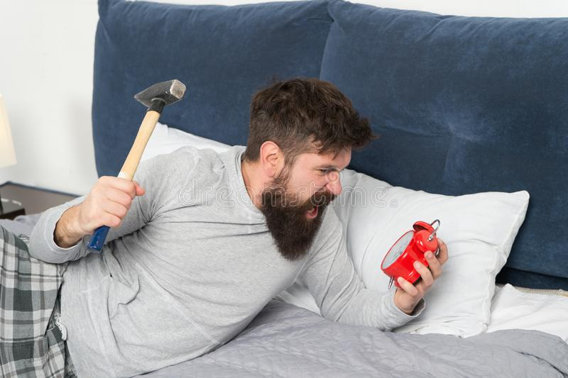 Sleep longer. Health care concept. Although you sleep you may wake up feeling like did not sleep at all. Irritated guy. Destroy annoying clock. Stages of sleep stock images