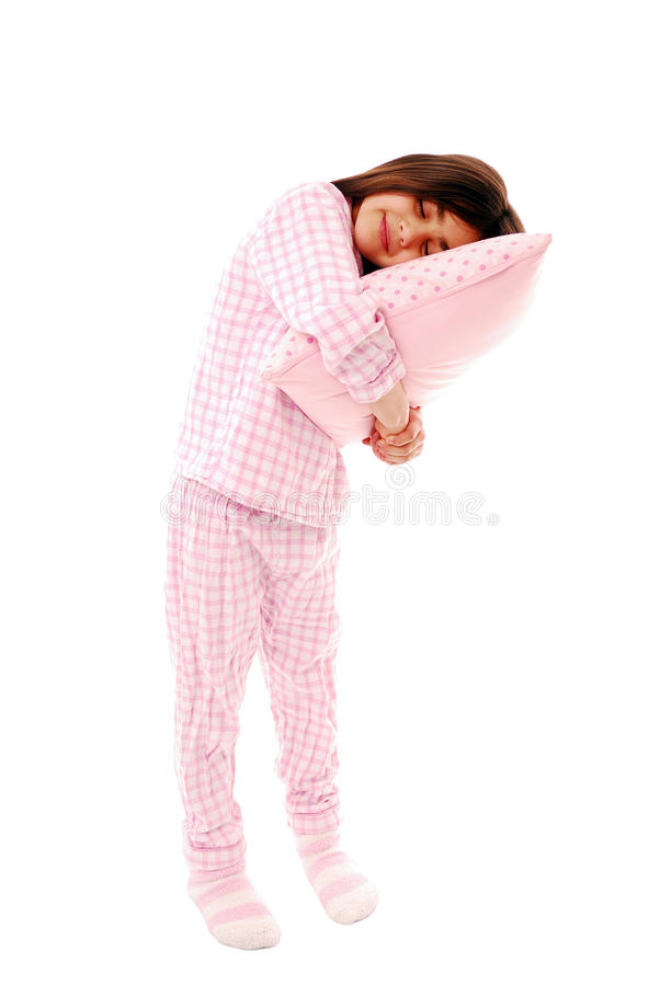 Sleeping. Cute little girl ready for bed isolated on white royalty free stock photo
