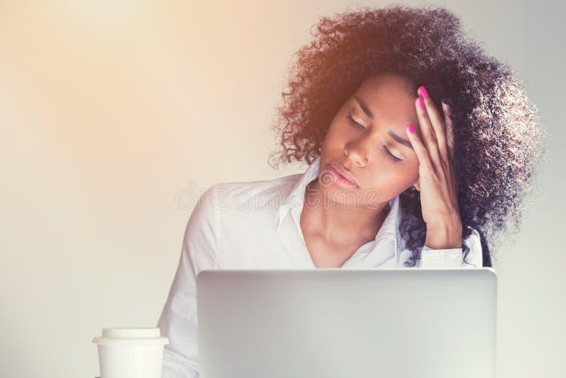 Sleeping African American woman at work stock photos