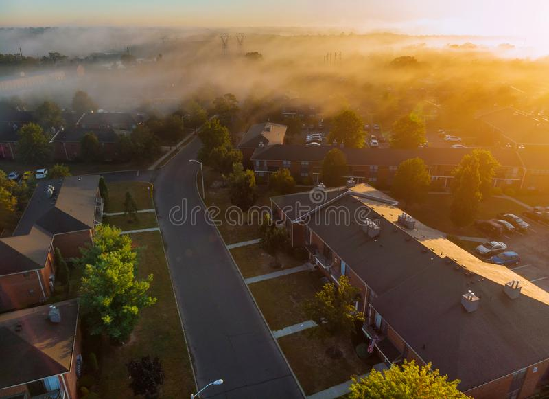 The sleeping area with apartment buildings aerial view of beautiful of the river a height with fog morning of river royalty free stock photography